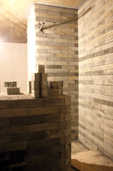 A wall built with concrete based lead-free bricks, for radiation shielding