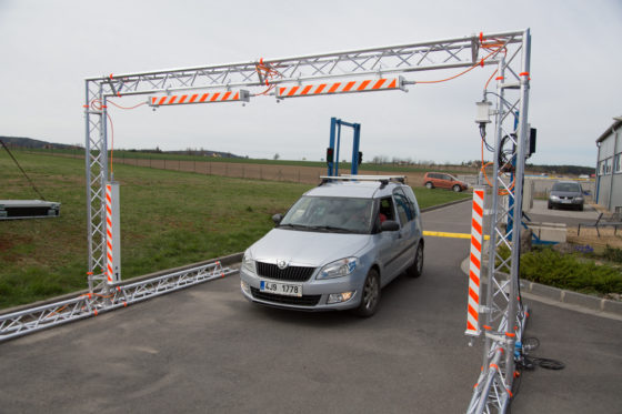 A radiation portal monitoring system for vehicles installed on a road
