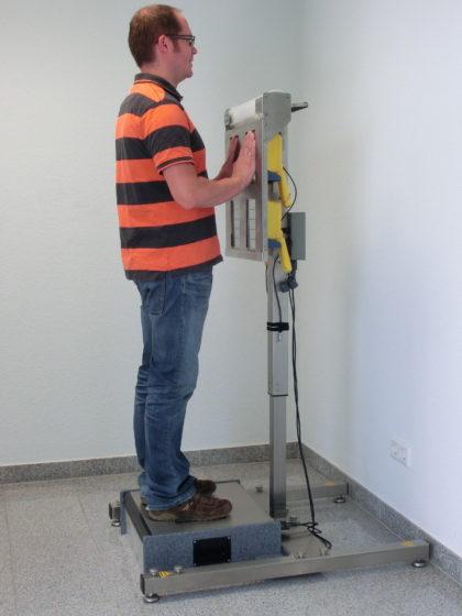A man using an emergency contamination monitor