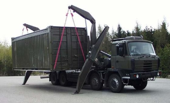 A truck installs a mobile radiochemistry laboratory