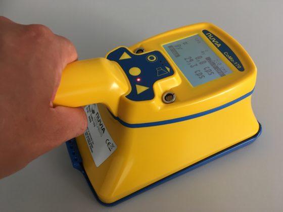 A hand-held contamination monitor