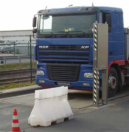 A truck crossing a radioactivity monitor on a road