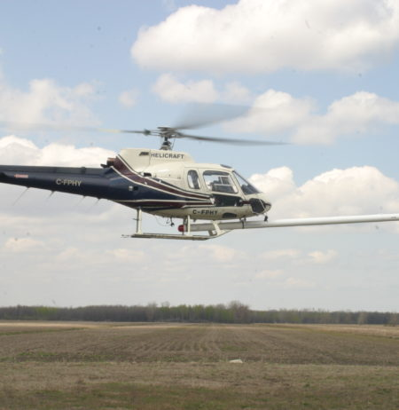 Power distribution system attached to a helicopter